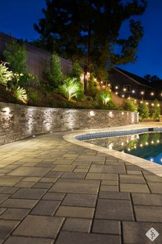 This full front and backyard remodel includes a new paver patio, pergola, custom paver planters and retaining wall, a built in fire pit and elegant landscape lighting. Backyard Retaining Walls, Backyard Pool Landscaping, Backyard Pool Designs, Fire Pit Backyard, Retaining Wall Lights, Front Garden Landscape, Patio Wall, Backyard Lighting, Landscape Lighting