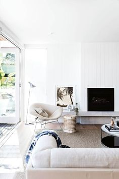 All white neutral modern living room design. Love the white fireplace and white furniture like the white sofa! Coastal Living Rooms, My Living Room, Home And Living, Living Room Decor, Living Spaces, Living Area, Coastal Cottage, Coastal Homes, Style At Home