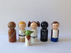 A must have for any Star Wars fan young or old. Hand painted set of 6 peg dolls. Each doll stands 2 3/8 tall(yoda stands at 1 5/8). Painted with non toxic acrylic and two coats of non toxic sealer. Set includes: Darth Vader, Hans Solo, Princess Leia, Chewbacca, Yoda and Luke
