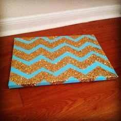 DIY Glitter Chevron Art- Use tape to mark lines over painted canvas, and paint over the untaped parts with modpodge. Sprinkle gold glitter all over the modpodge and shake off when dry. Easy and awesome.