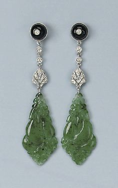 A PAIR OF ONYX, DIAMOND AND JADE EARRINGS   Each designed as an onyx and diamond stud suspending a diamond-set leave and a carved jade pendant, 7.0 cm long