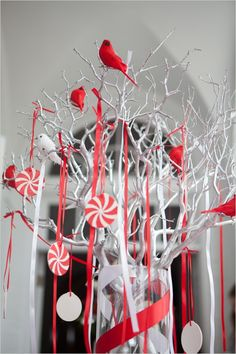 spray painted branches with birds and ribbon