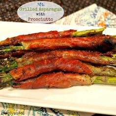 Grilled Asparagus with Prosciutto - simply scrumptious. Fresh asparagus wrapped with prosciutto and grilled to perfection. Perfect as an appetizer or side.