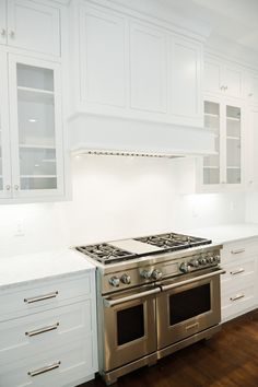 White inset cabinets and hood design -- Studio McGee. Kitchen Cabinet Knobs, White Kitchen Cabinets, Kitchen Backsplash, Kitchen White, Kitchen Cabinetry, Kitchen Appliances, Studio Mcgee, Oven Hood, Inset Cabinets