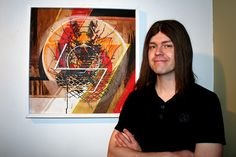 Jason Reed poses with one of his paintings at Start Gallery.