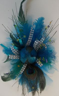 Gorgeous peacock inspired silk wrist corsage on matching bracelet style wristlet.