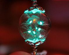 Cracked clear round crystal pendant GLOW in the DARK by Papillon9