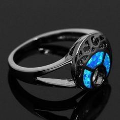 Black Gun Plated Blue Moon Fire Opal Ring ($26) ❤ liked on Polyvore featuring jewelry, rings, fire opal ring, blue jewellery, party rings, blue ring and wedding band ring