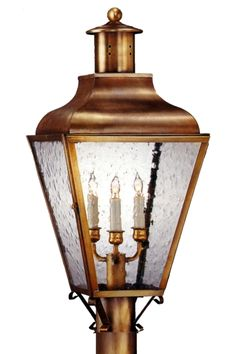 Portland Post Mount Copper Lantern by Lanternland, shown here in Antique Brass with Seeded Glass, is made in America from high quality brass or copper and is designed to last for decades. Available in wall light, wall sconce, post light and pier-base versions in a variety of size, finish and glass options, the classic elegant style will complement any decor.