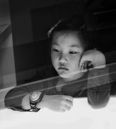 Portrait of a Korean girl through a window © Salvador San Vicente  #Black and White #portrait #photography #fine art photography