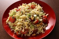 Orzo Salad with Tomatoes and Pine Nuts  I added a spinach basil pesto that I made. It was quite delicious.