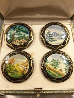 Set of 4 paper mache buttons with beautifully hand painted scenes of Blue Ridge Parkway by the Russian artist M Hobnkoba. Signed and dated 1996 on the reverse. Approx diameter is 40mm. These buttons are one of a kind.