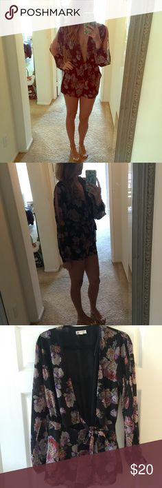 Black floral romper Floral, long sleeved romper with low cute neckline & cutouts on the sleeves. Nasty Gal Other