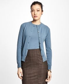 """Made of pure Italian cashmere with fine Cariaggi yarn, this long-sleeve cardigan features an elegant trim detail at the neck, a grosgrain trim along the inner placket, and logo pearl shank buttons down the front.<br><br>23 ¼""""; dry-clean only; made in Italy."""