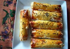 Potato Cigarette Borek - a Turkish pastry with mashed potatoes, onions and feta cheese in puff pastry rolls. Empanadas, Puff Pastry Recipes, Turkish Recipes, Moroccan Recipes, Greek Recipes, Yummy Recipes, Eastern Cuisine, Middle Eastern Recipes, Fresh Fruits And Vegetables