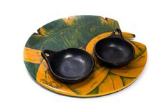 Feel like youre in the tropical rain forest every time you use this lazy Susan, beautifully hand painted with bananas and leafs