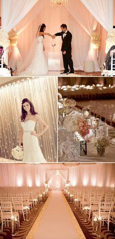 Drape and lighting transform a ballroom into a romantic ceremony space