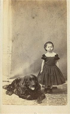 CDV Little girl with large dog.  Possible PM - wooden stand in back holding little girl up.