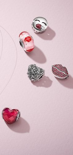 Make a loving statement this Valentine s with soft nuances of red and pink  and the cutest kisses. Donna G · Pandora and other charms aabbac398df