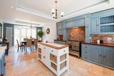 exposed brick wall Kitchen Victorian with chandelier brick backsplash