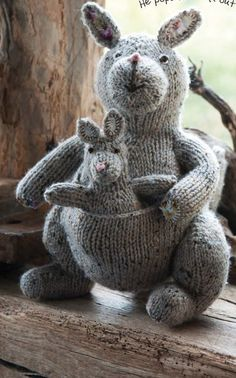 Knitting pattern for Kath the Kangaroo with baby Joey in pocket. Finished Sizes Kath: 12 1/2in (32cm) tall Joey: 6 1/4in (16cm) tall Etsy affiliate link tba More