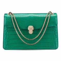 This one-off Bulgari Serpenti Forever emerald-green crocodile skin handbag features a gold and diamond clasp