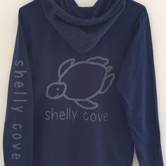 Unisex Lightweight Long Sleeve Hooded Tee with Pewter Gray Drawstring Feel comfortable in your Shelly Cove… - Pewter Gray logo arm imprint - Pewter Gray signature Shelly Turtle - Relaxed unlined hood