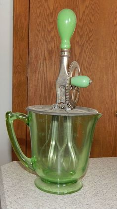 Green Depression Glass Hand Mixer Vintage Kitchen Utensil Saw this at our local antique store just last week :)