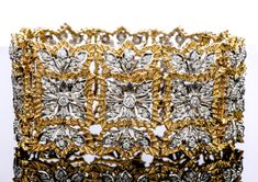 This 1980 bracelet crafted in Rigato textured 18 karat white and yellow gold. Elaborately detailed in its design and texturing gold to simulate an embroidered pattern rendered in gold. 18k Gold Bracelet, Antique Bracelets, Bracelet Crafts, Bracelet Designs, Texture, Retro, Antiques, Yellow, Diamond