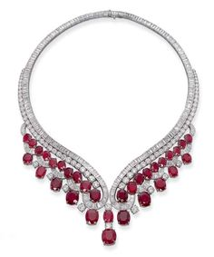 An important ruby and diamond necklace by Harry Winston. Of V-shaped design, the two baguette and brilliant-cut diamond rows suspending a fringe of oval and cushion-cut rubies, 41.0 cm long. Rubies are Burmese in origin.