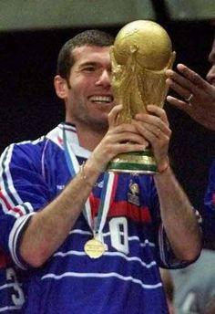 Zinedine Zidane was instrumental in France's World Cup Winning team of He scored twice in the final against Brazil. Worldcup Football, Football Soccer, Football Shirts, Michel Platini, Zinedine Zidane, Thierry Roland, France 98, Legends Football, Most Popular Sports