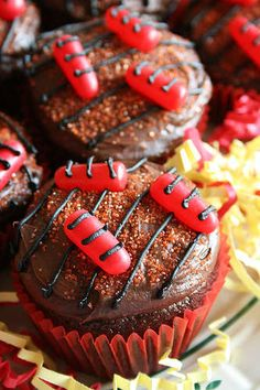 Make Dad some Bite-Sized BBQ Cupcakes. Sorry no directions, just this photo, but I think it's easy enough to replicate them. Just use Hot Tamales candies that have been piped with black royal icing.