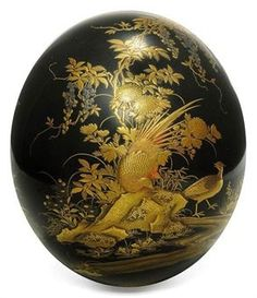 An Ostrich Egg  Meiji Period (late 19th century)  Decorated in gold, silver and red hiramaki-e, takamaki-e, togidashi-e and kirigane on an unusual black ground with pheasants and quail amongst rocks and flowers beside a stream 14.5cm. high
