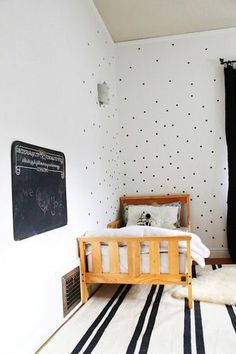 The black polka dots on the walls are a favorite. The chalkboard accent a close second!