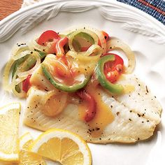 Fish and Peppers Recipe Main Dishes with cod fillets, chicken broth, onions, dried oregano, lemon peel, lemon juice, garlic, sweet pepper, sweet pepper, corn starch, lemon, water