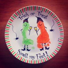 Makes some funky Halloween Cookie plates this year with your kids prints.  Permanent markers and cheap ceramic paints baked in the oven at gas mark 4 for half an hour makes these plates permanently beautifully decorated.