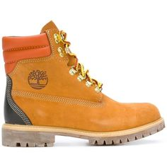 Orange calf leather lace up hiking boots from Timberland. Color: Brown.  Gender: Male.  Material: Calf Leather/Leather/rubber.
