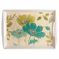 "Serving tray with a floral motif and cutout handles.  Product: Serving trayConstruction Material: MelamineColor: White and blueFeatures:  Floral design Handles for easy serving  Dimensions: 4"" H x 19"" W x 14"" D"