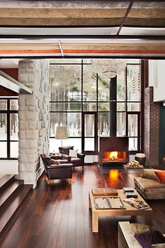 Modern living room with fireplace and wall of windows