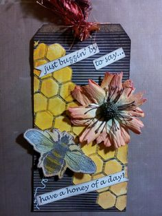 MME paper tag, Heidi swapp stencil and texture paste, smooch Spritz in yellow, naturals canvas bee sticker, prima flowers, distress stains, distress paints, distress ink, stampin up stamp just buzzin by...created by Diane K
