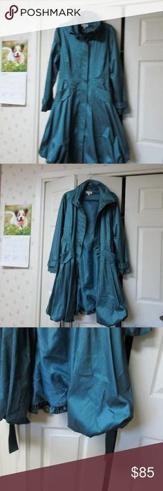 MONROE & MAIN TEAL LONG FITTED TRENCH COAT NEW MONROE & MAIN TEAL LONG FITTED TRENCH COAT BUBBLE BOTTOM. SIZE L NEW WITH TAGS NEVER WORN. HAS STRETCH TO IT. THIS IS NOT A RAINCOAT. Polyester NYLON SPANDEX. ILL CONSIDER ALL OFFERS ON MY ITEMS. THANKS Monroe & Main Jackets & Coats Trench Coats