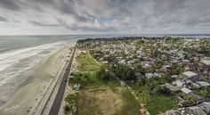 Bengkulu Skyline http://www.brucelevick.com/bengkulu-skyline/ Looking out over the Bengkulu skyline with the ocean views. I love to imagine the history of Bengkulu and the old ships from centuries past discovering new sights, sounds and cultures.   #Aerial, #Drone, #Photography, #Sumatra, #Travel, #VisitBengkulu