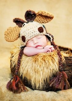This cute little Moose has been hand crocheted using a soft multicolored brown acrylic yarn. Nose is in Oatmeal - and his little antlers are to die for! He sports cute earflaps and little braids. He c