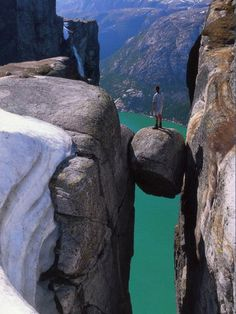Kjeragbolten is a boulder wedged in a mountain crevice in the Kjerag mountains in Norway. Below the boulder is a sheer drop of about 3200 feet (1000 meters) to Lysefjorden
