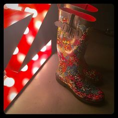 Capelli Floral Rain Boots! size 7 Almost New Capelli Floral Rain Boots!! Size 7. Black with super cute floral design. Perfect for the upcoming Spring and Summer months! Don't miss out!!! Capelli Shoes Winter & Rain Boots