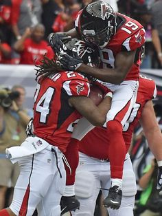 Atlanta Falcons wide receiver Aldrick Robinson (19) celebrates Atlanta Falcons running back Devonta Freeman's touchdown against the Carolina Panthers during the first half of an NFL football game, Sunday, Oct. 2, 2016, in Atlanta.