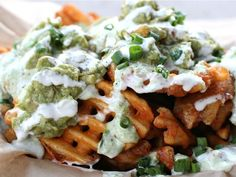 "The Lobos Truck, also in Los Angeles, serves a dish they call the ""green dragon wachos"": waffle fries with green dragon sauce, guacamole, scallions, and ranch."