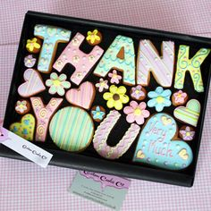 Large 'Thank You' Cookies Gift Box    Hand decorated letter, heart & flower cookies presented in a premium gift box. Heart cookie in the box can be personalised with up to 5 words and box contains a ribboned gift tag bearing your special message - add cookie personalisation and gift tag message at checkout.    £26 per large gift box. Box size 315mm x 220mm