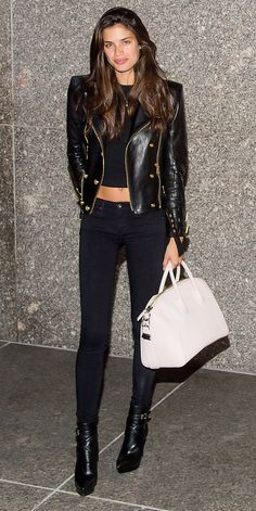 Victoria's Secret model Sara Sampaio showed off her toned physique with high-waist skinnies and a crop top that revealed a sliver of skin. Lend edge with a black moto jacket and booties.
