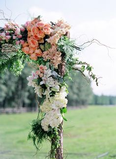 Simple arbor structure with gorgeous flowers. Lauryl Lane